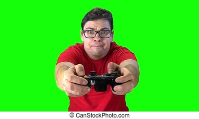 Man holding game controller playing video games. Green...