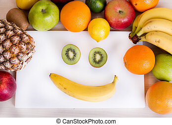 Smiley face with fruits - Smiley face made from kiwi slices...