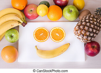 Smiley face with fruits - Smiley face made from orange...