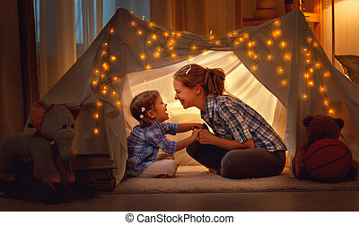 happy mother and daughter playing at home in tent - happy...