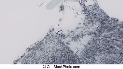 Flying over the snowy expanse and icy lake. - Shooting the...