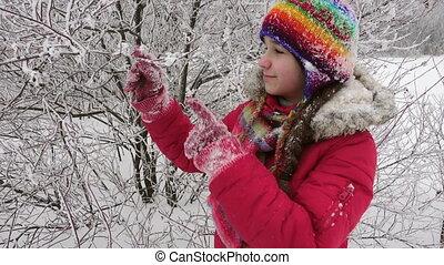 Adorable girl with icy branches on winter forest - Adorable...