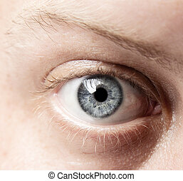 Closeup of a blue eye, of a Caucasian man, showing intricate...