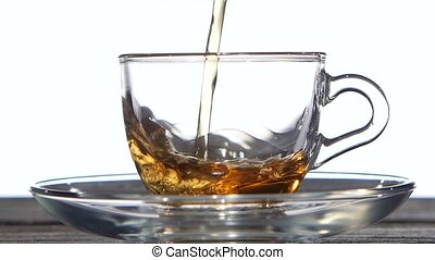 Refreshing cup of green tea. Closeup. Slow motion -...