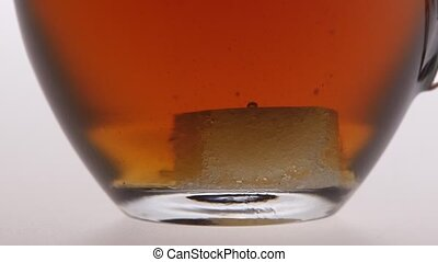 Time lapse. Sugar is dissolved in the cup of tea - Sugar is...
