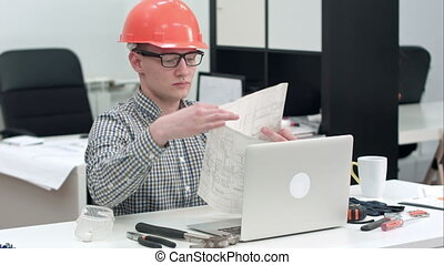Engineer explaining technical drawing during video call via...