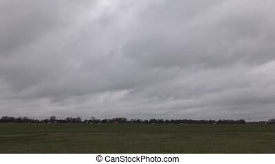 Time lapse. Beautiful clouds over the field. - London....