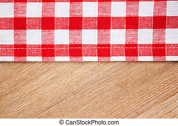checkered tablecloth on wooden table - the checkered...