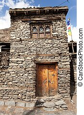 View of local stony building in Manang village one of the...