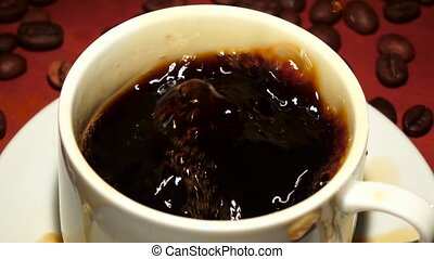 Closeup. In cup with black coffee falls one piece sugar - In...