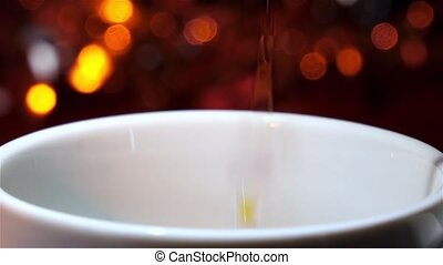 Black coffee poured in a white cup. Slow motion - Pouring...