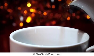 From the pot poured hot delicious flavored coffee. Slow motion