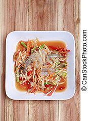 SOM TUM,Thai foods or papaya salad in spicy taste and is...