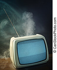 vintage television - broken tv about to explode Studio shot,...
