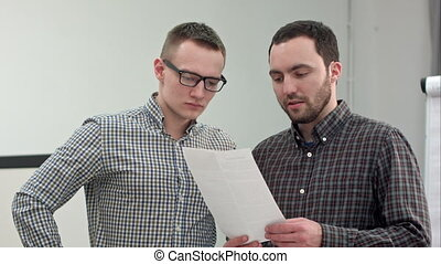 Two partners reading contract in the office