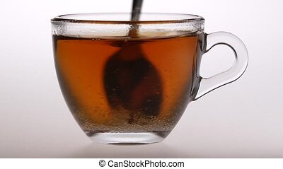 Spoon stir sugar in black tea. Slow motion - Spoon stir...
