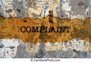 Complaint text on wall