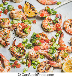Close-up of grilled tiger prawns over white background,...