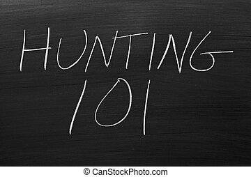"Hunting 101 On A Blackboard - The words ""Hunting 101"" on a..."