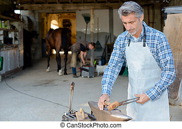 farrier making a hoof