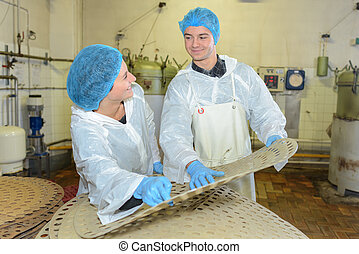 Young people working in factory