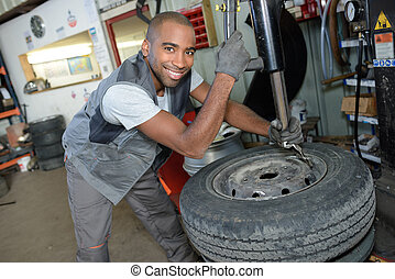 tire technician posing