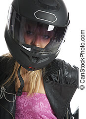 The beautiful girl with a motorcycle helmet