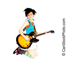 Young girl jumping with a guitar on a white background