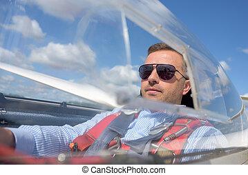 pilot inside a glider