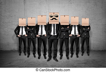 Leader and his staff staying together with boxes on their...