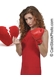 Broken Heart - Beautiful woman in wearing a boxing glove in...