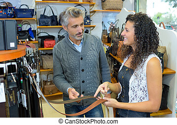 Customer looking at leather belts