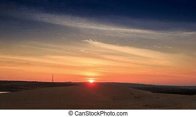 Sundisk on Skyline at Sunset in White Sand Dunes - orange...