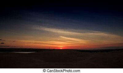 Sundisk on Skyline at Sunset in White Sand Dunes - orange...