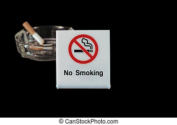 no smoking sign with ashtray and cigarette on black...
