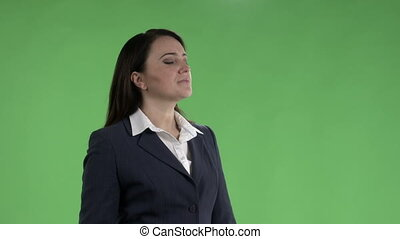 Woman looking at watch and checking schedule on departure board against a green screen