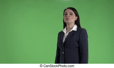 Business woman presenting something against a green screen...