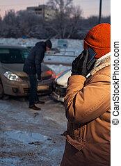 Man calling to car assistance after crash