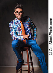 relaxed young business man wearing glasses and sitting -...