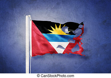 Torn flag of Antigua and Barbuda flying against grunge...