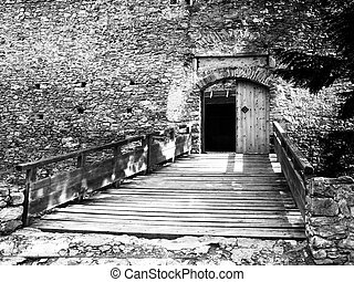 Entrance wooden bridge and gate of medieval stronghold...