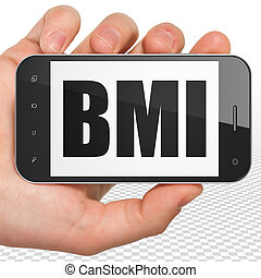 Medicine concept: Hand Holding Smartphone with BMI on...