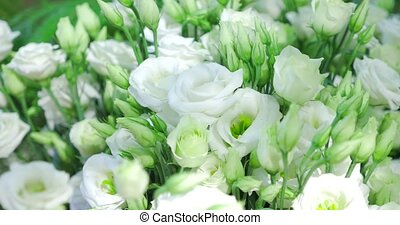 Detail of bridal bouquet of white roses