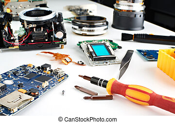 Screwdriver in workplace service engineer to repair cameras...