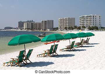 Destin Beach - Tourists relax laying on the beach behind...