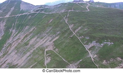 Aerial flight to Omu chalet, Bucegi mountains, Romania
