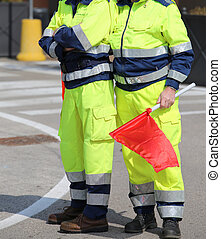 men of the Italian civil protection with garish uniform and...