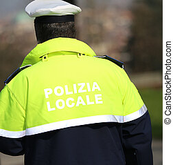 traffic cop with uniform with the words local police in...