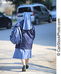 nun with a blue suit and small backpack - nun with a blue...