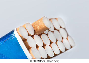 Open pack of cigarettes with a one protruding cigarette...